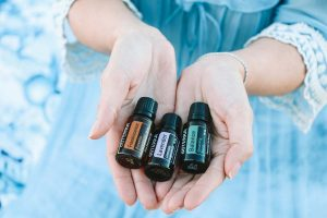 Free Essential Oil Samples - Woman Holding DoTerra Oils